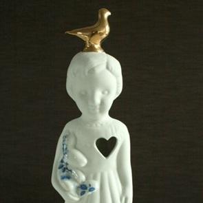 Popje gouden duif
