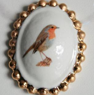Broche roodborst klein