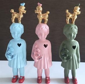 Pink doll gold poodle