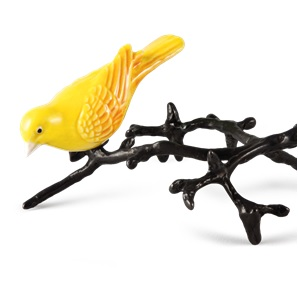 Gele vogel op tak