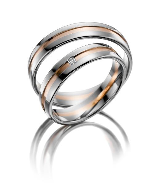 Bicolor trouwringen. Heren ring gratis