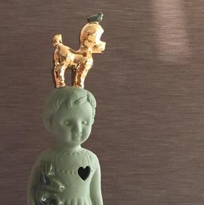 Groen popje goud poedel