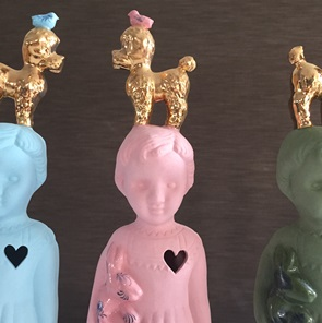 Pink doll gold poodle