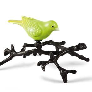 Groene vogel op tak