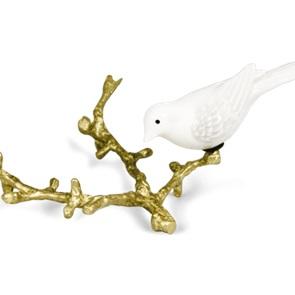 Witte vogel op gouden tak