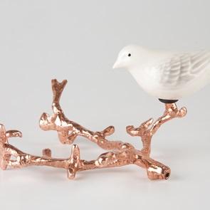 White bird on copper branch