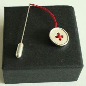Zilveren knoopspeldje