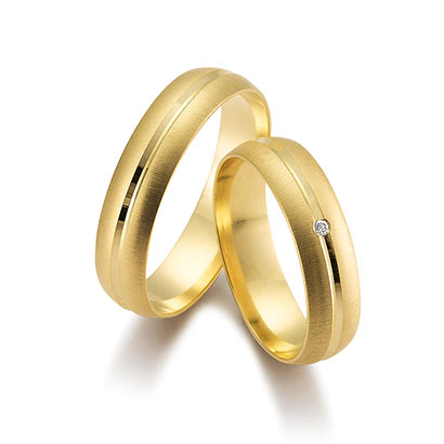 Gouden trouwringen.Herenring gratis