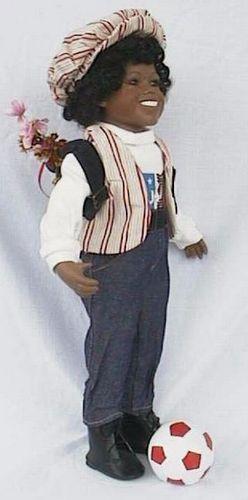 Porseleinen pop jongen bruin 47 X 22 centimeter