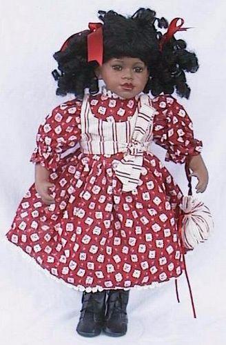 Porseleinen pop meisje bruin 45 X 23 centimeter