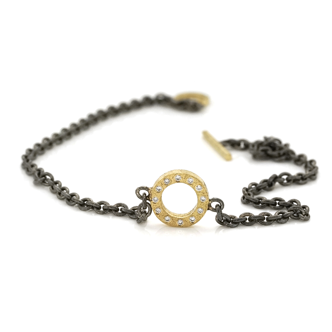 Bracelet with open circle and diamonds