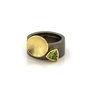 Silver stacking rings with 18k gold and peridot